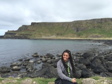 Me sitting on a rock at Giants Causeway