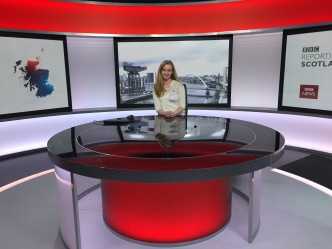 Me sitting at the desk of on of the BBC's news studios.